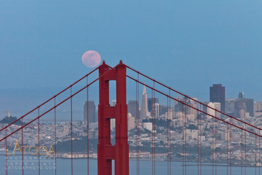 May 2012 Super Moon rising over Golden Gate Bridge with San Francisco in the distance.