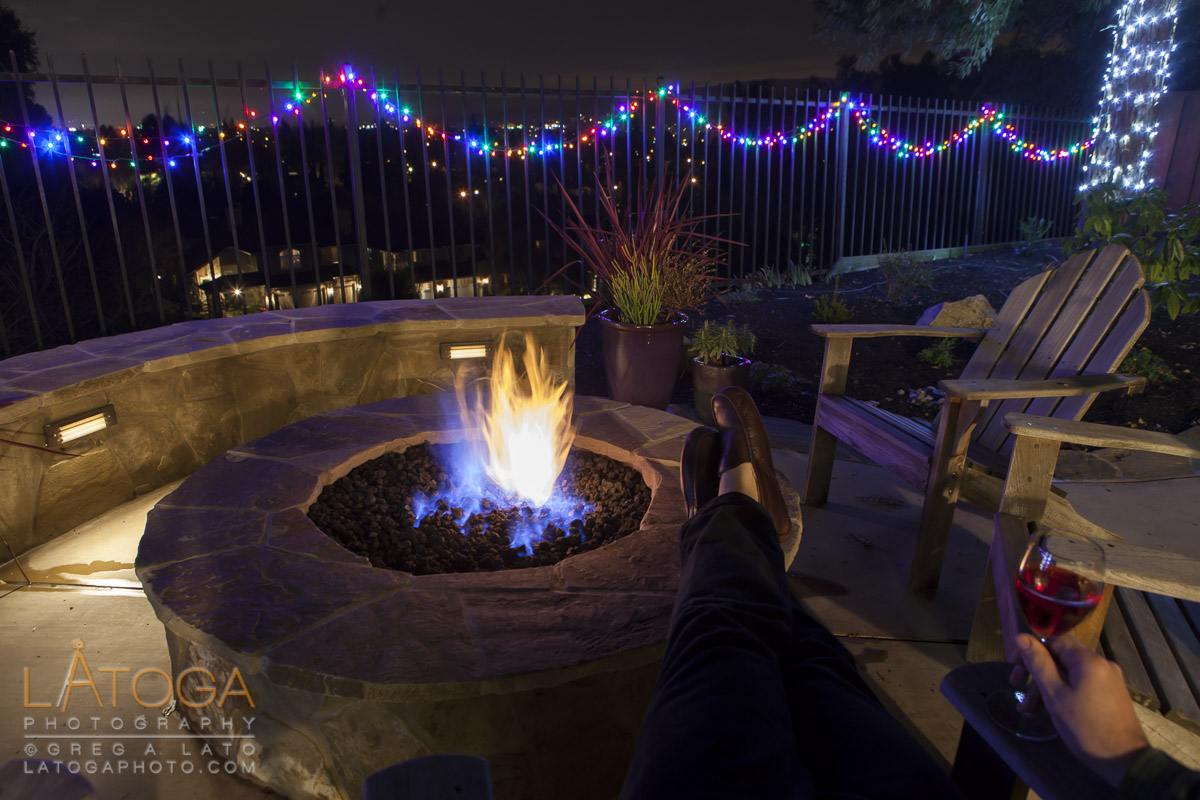 Enjoying a moment of holiday solitude sitting by the backyard fire pit.
