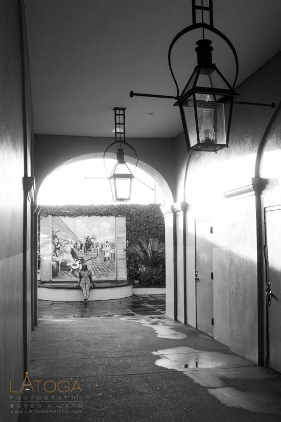 Statue and Empty Breezeway in French Market building on Decature Street