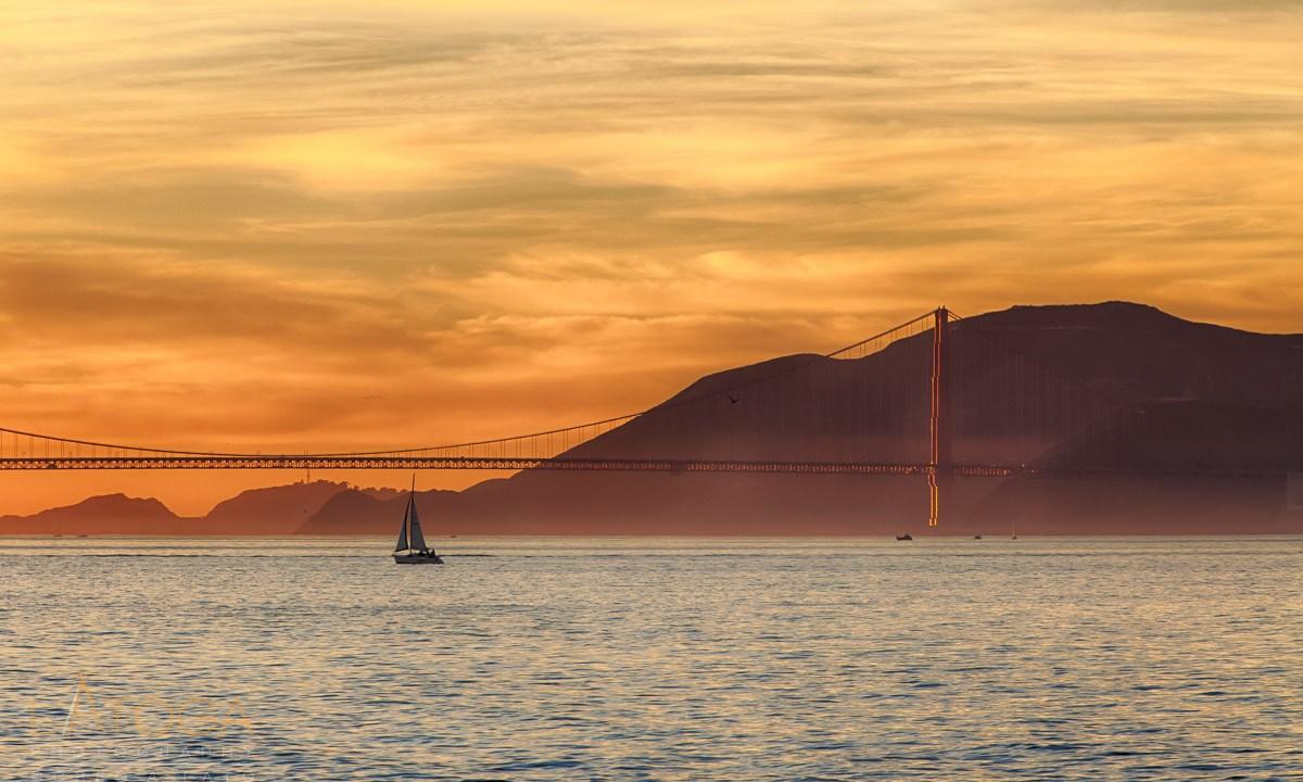Sailboat Crosses San Francisco Bay at Sunset