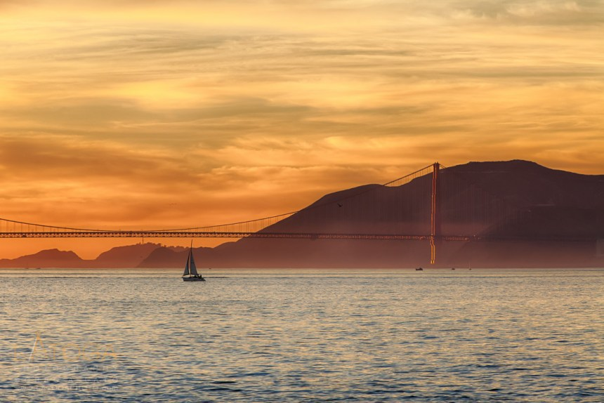 Sailboat Crosses San Francisco Bay at Sunset