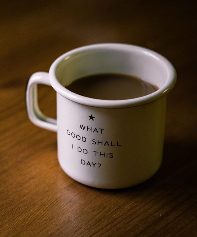 Cup of coffee with quote of What Good Can I Do Today