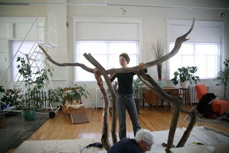 Laüra Hollick creating dragon sculpture with her dad