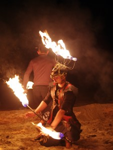 Kneeling fire dancer
