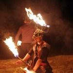 Kneeling fire dancer