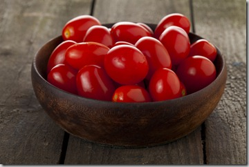 a bowl of fresh tomatoes