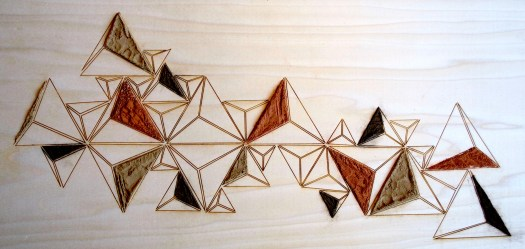 Soil composition by Luke Williams (UA art student). Laser cut pattern on wood filled in with some of my soil samples.
