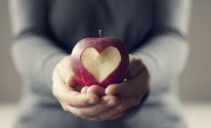 Person-Grey-Pants-Sweatshirt-Holding-Apple-With-Heart-01192015