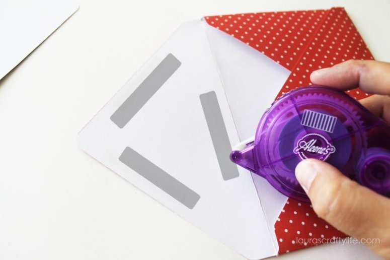 Add adhesive to inside of envelope flap