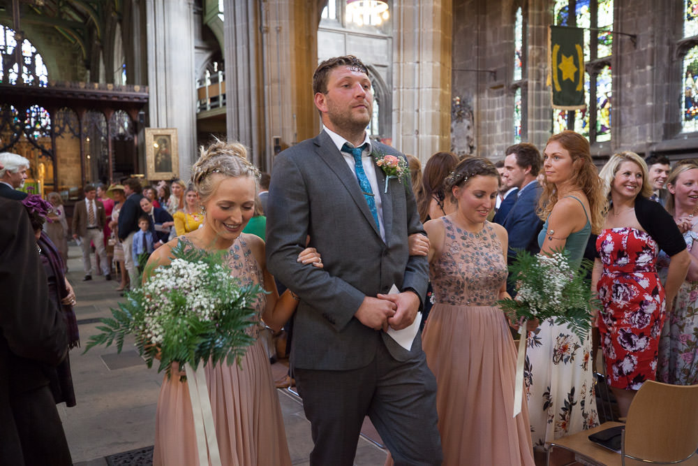 Brides brother takes the bridesmaids down the aisle in St Mary's Church the best Nottingham Wedding venue