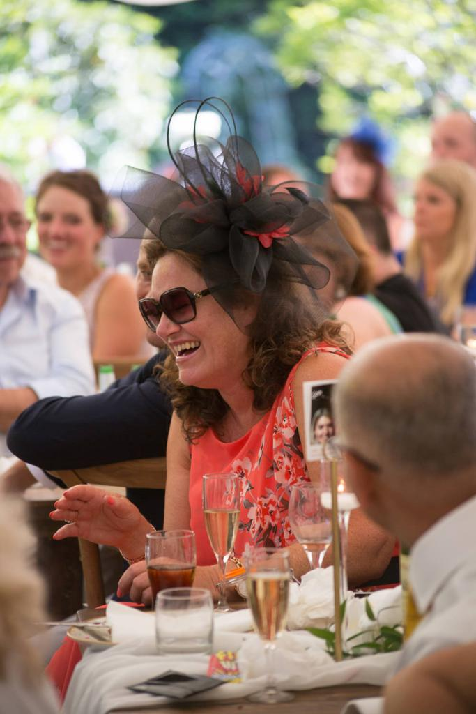 Guest roar with laughter at speeches at Tros Yr Afon wedding venue, DIY castle wedding