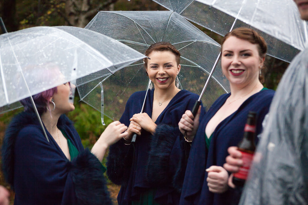 bridesmaids smiling excitedly wedding guests walk down to the beach ceremony at Isle of Skye Wedding