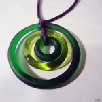 a photo of some green glass circles tied with cord