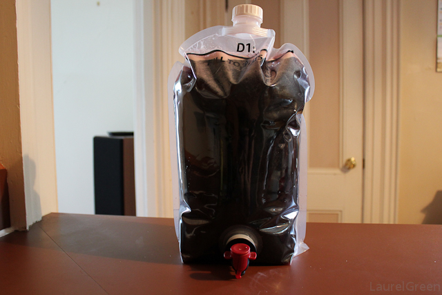 a photo of a fermenting bag full of grape juice with yeast added