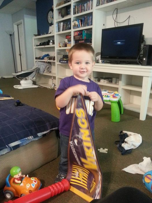 Why Yes I do like the Minnesota Vikings (I swear it was on the day I put him in that shirt he found that sign to play with)