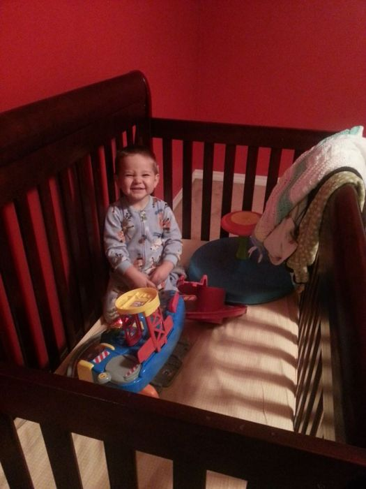 Why Yes I can crawl into my crib by myself (thankfully he hasn't figured out how to get out by himself)