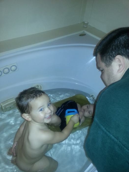 Why Yes I do like to water my brother during bathtime