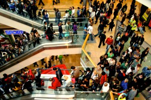 Photo: Crowds of people on escalators in a shopping mall