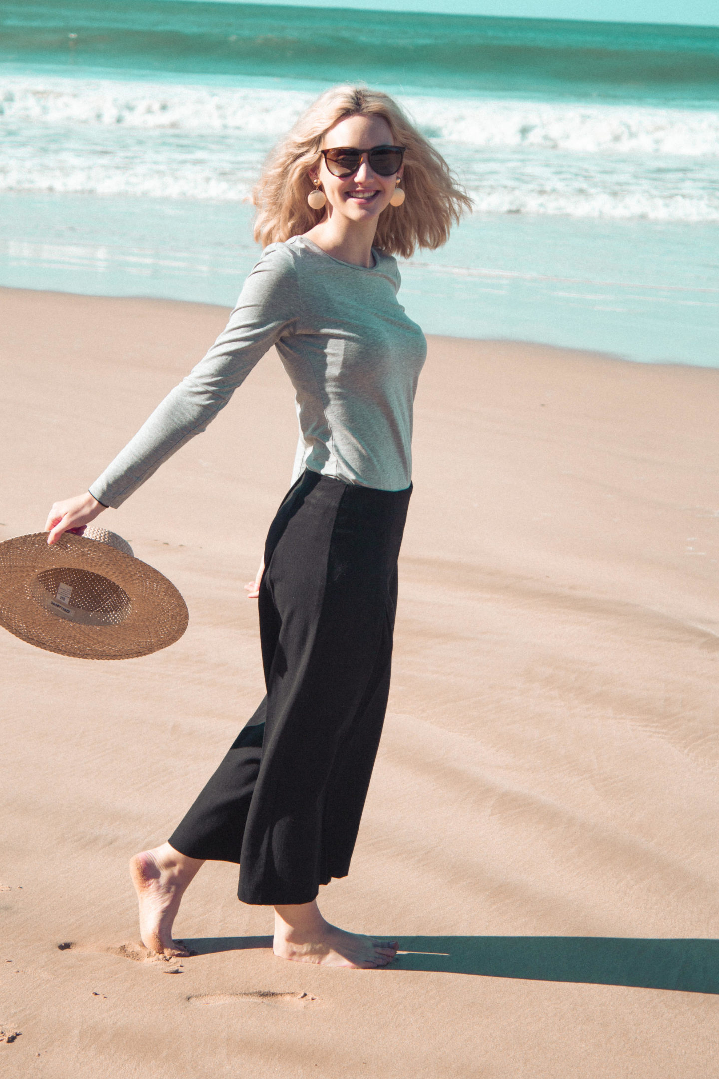 Girl on beach wearing culottes