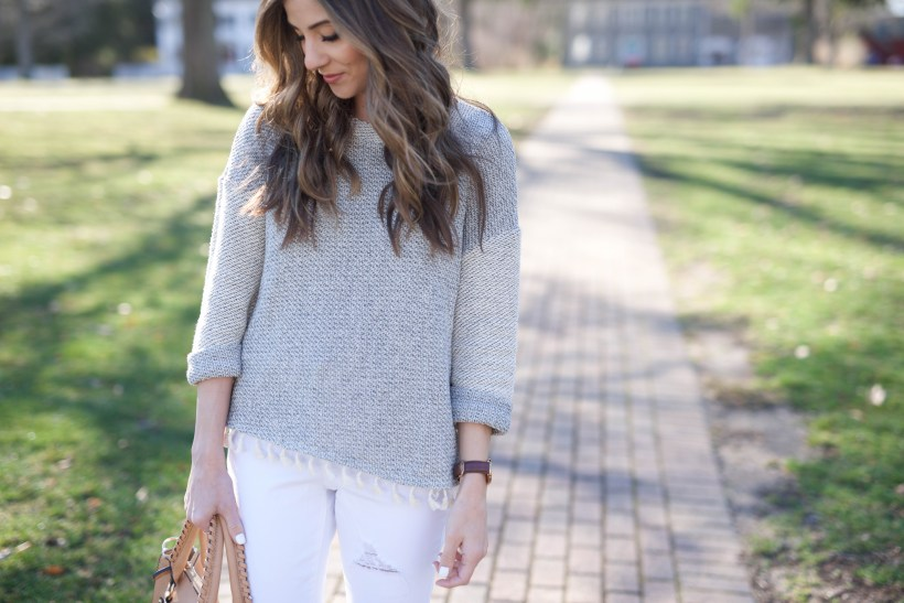 This lightweight boho fringe sweater is perfect paired with distressed white skinnies for spring fashion