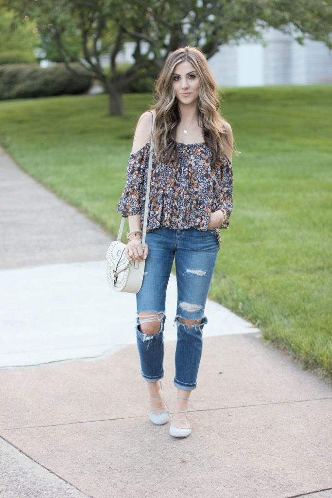 Spring styling this floral cold shoulder top with the perfect pair of distressed denim and gray lace-up flats.