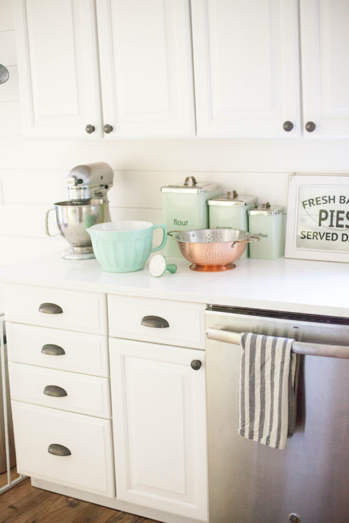 Mint and copper details from World Market in a farmhouse kitchen