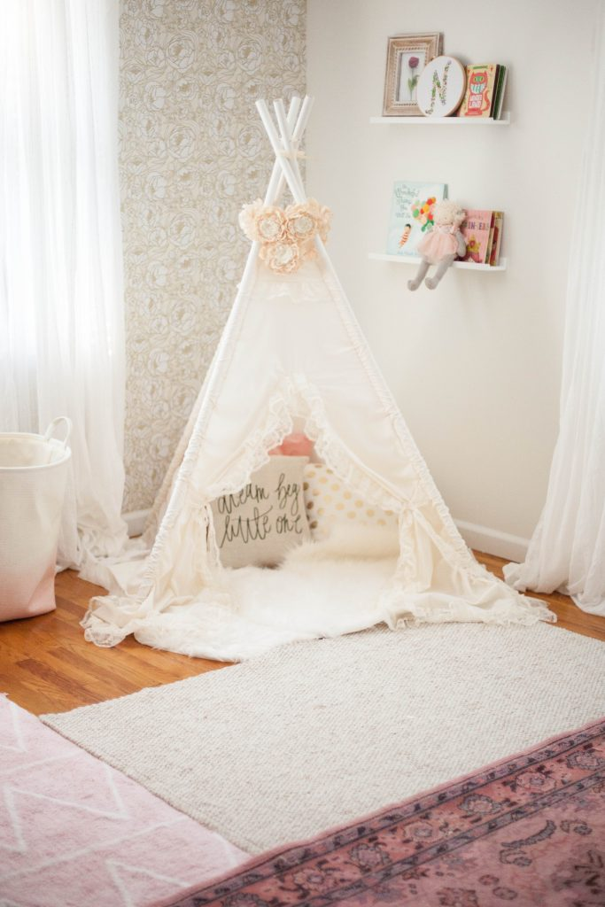 Layering rugs in a whimsical, bohemian nursery