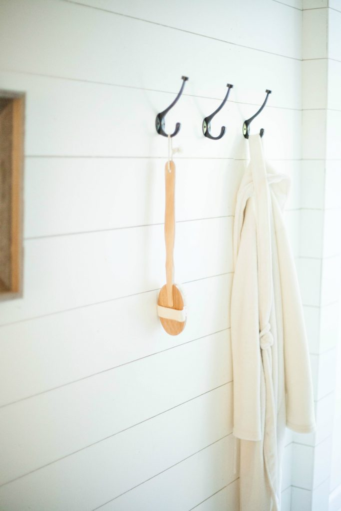 Wooden back bath brush on farmhouse hooks from World Market