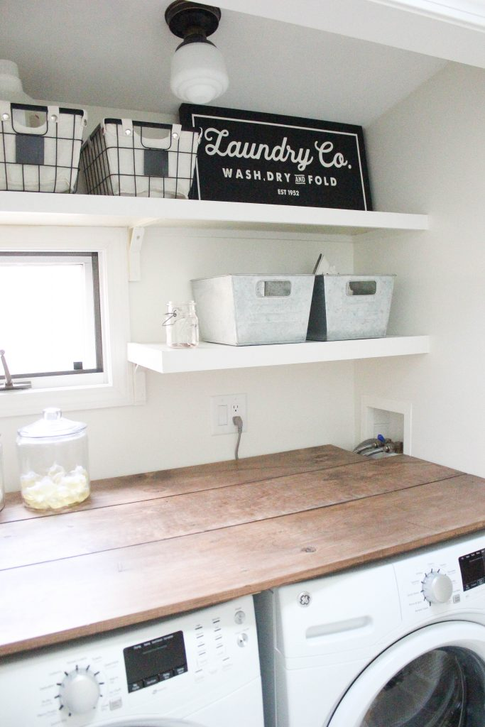 A budget-friendly farmhouse laundry room that's small, yet makes a large impact. The space is not only pretty, but functional for your laundry needs!