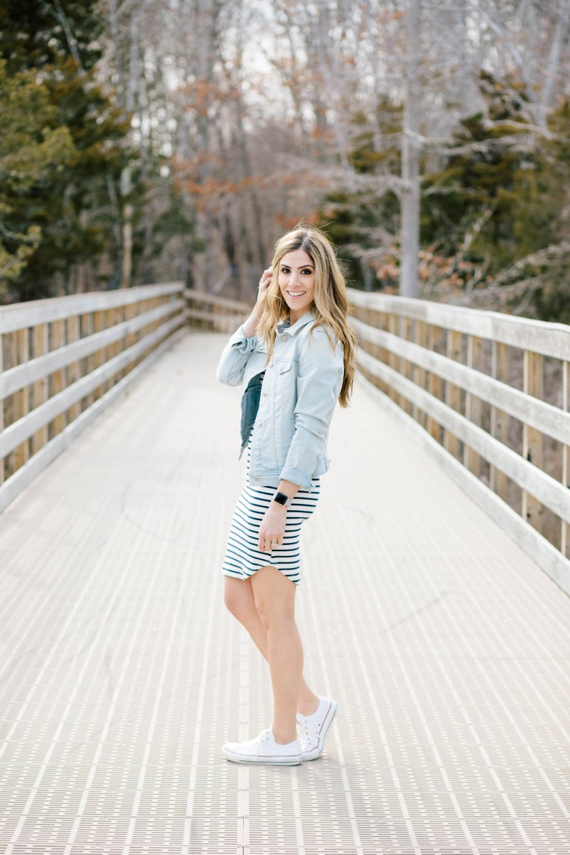 Need inspiration for how to style a striped dress? Adding a simple denim jacket and a pair of casual sneakers is just one of three ways featured in this post!