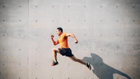 Sportsman jumping energetically.