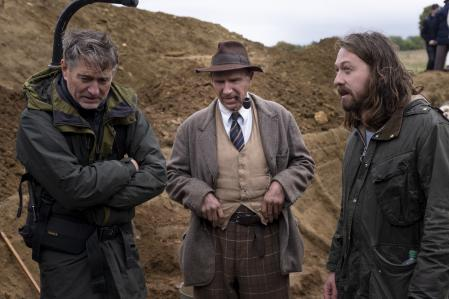 This image released by Netflix shows Director of Photography Mike Eley, from left, actor Ralph Fiennes and Director Simon Stone on the set of