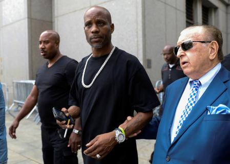 FILE PHOTO: Earl Simmons (C), also known as the rapper DMX, exits the U.S. Federal Court in Manhattan following a hearing regarding income tax evasion charges in New York City, U.S., July 17, 2017. REUTERS/Brendan McDermid/File Photo