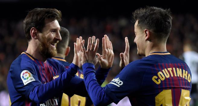 Philippe Coutinho celebra su gol con Messi