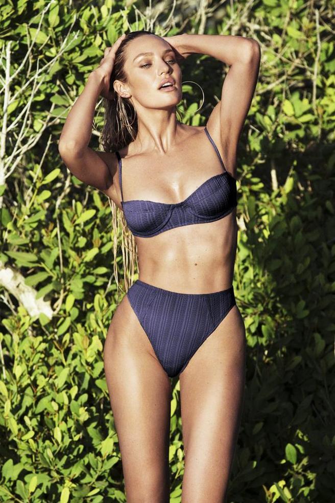 Candice Swanepoel con uno de los bañadores de su firma, Tropic of c