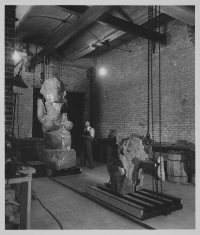 The large kneeling statue of Hatshepsut undergoing restoration.  Photograph of 24 October 1930