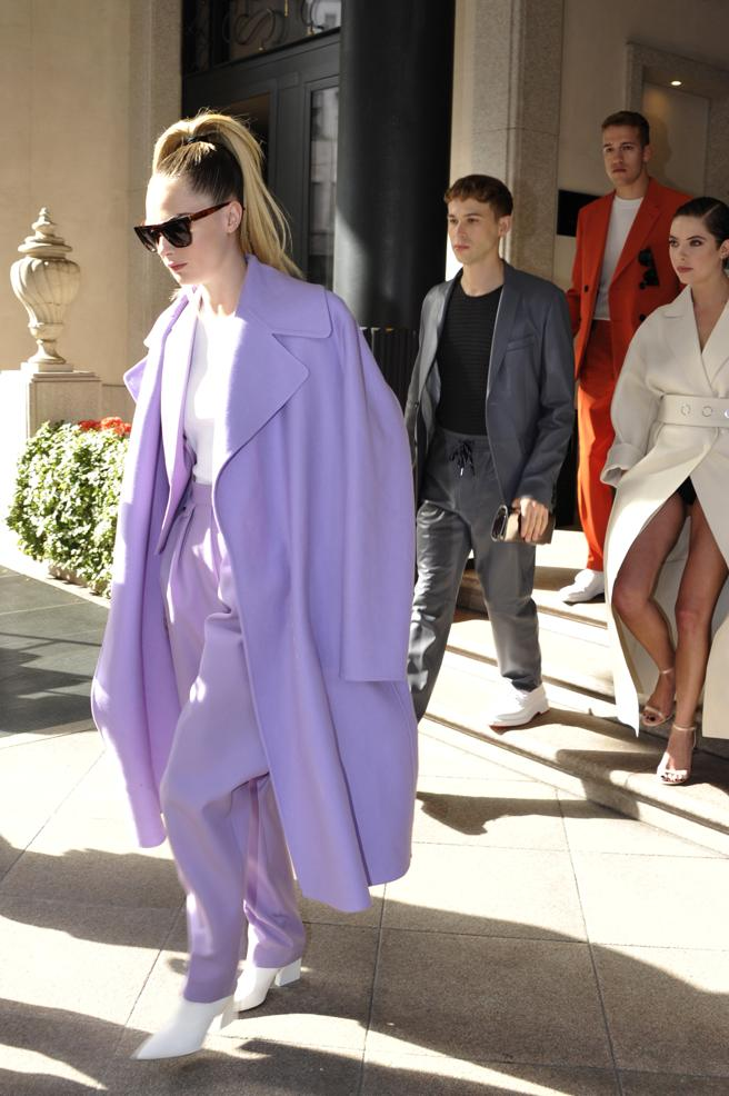 Cara Delevingne with the suit jacket and trousers and a coat by Boss