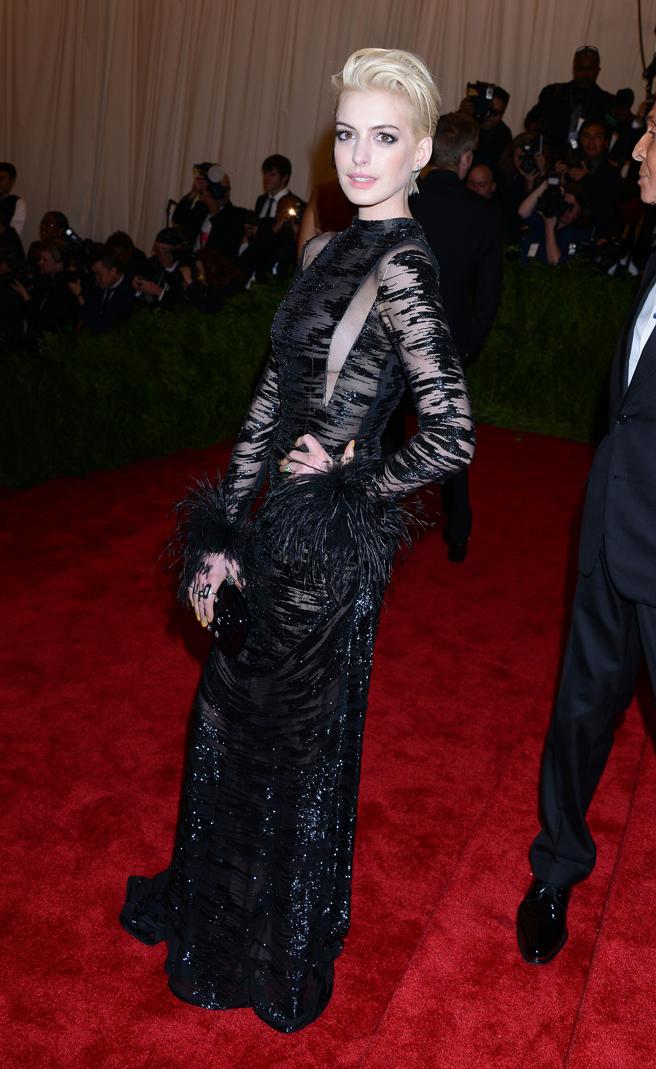 Anne Hathaway in a black dress with transparencies of Valentino