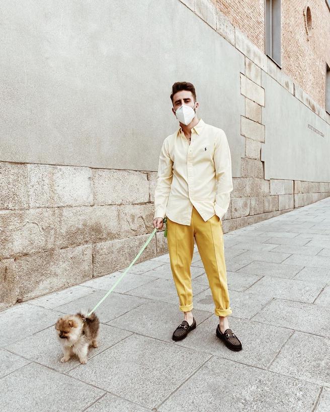 The stylist Pelayo Diaz walks her dog through the streets of Madrid