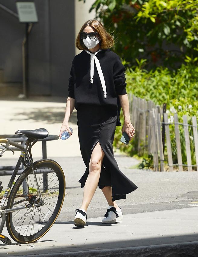 Olivia Palermo walks by your neighborhood of New York