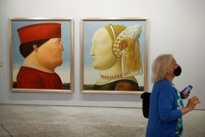 Visitors take a tour of the exhibition 'Botero: 60 years of painting' at the Centro Centro in Madrid