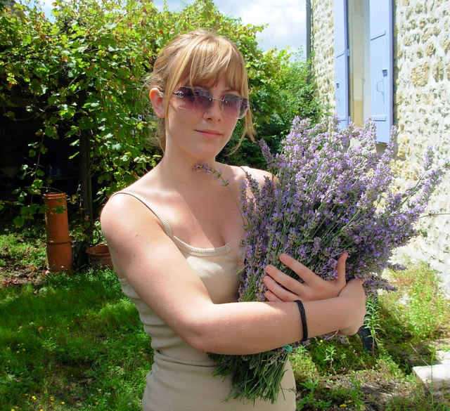 Hannah with a bunch of Lavender