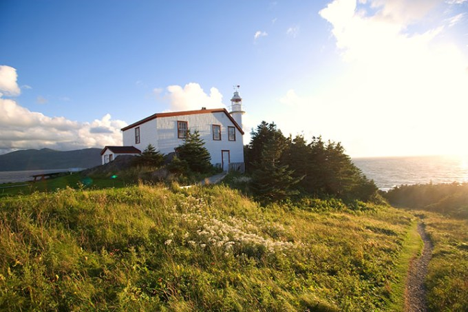 A lighthouse on a bluff overlooking the Atlantic