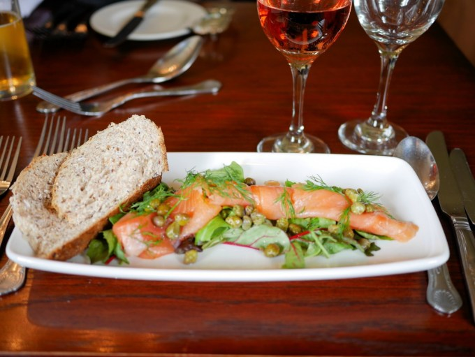 Smoked salmon platter with capers, dill and lemon,