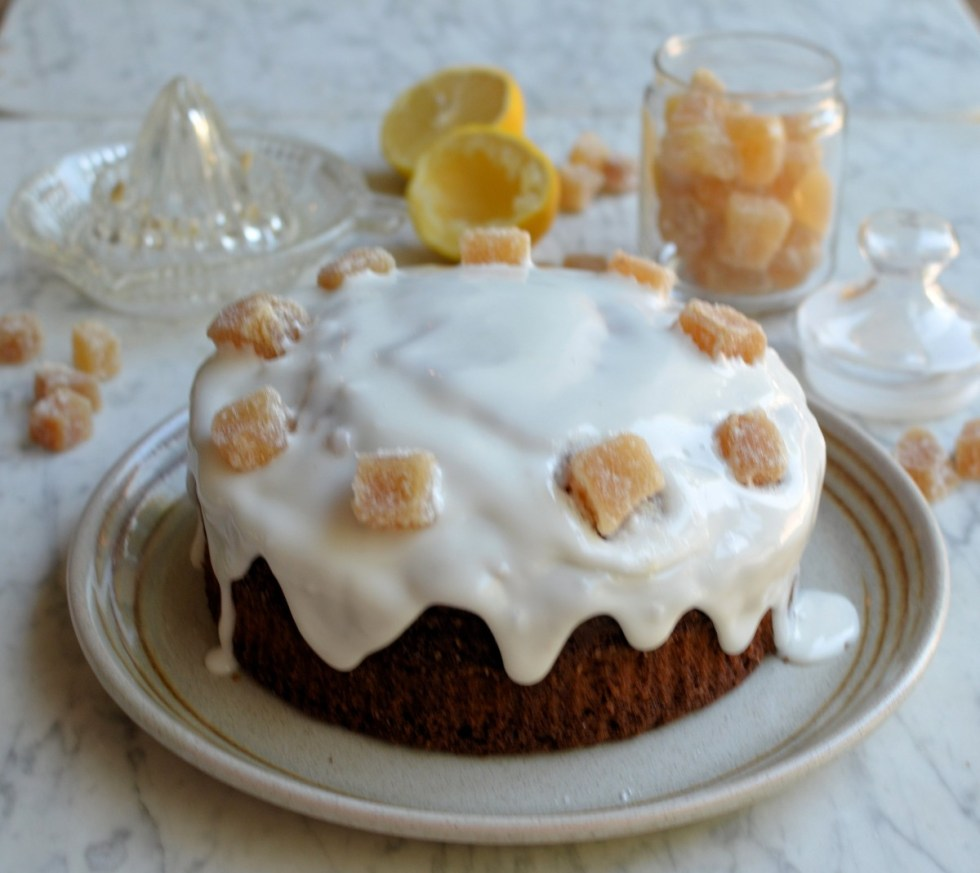 There is nothing wrong with a good old fashioned ginger cake, gingerbread loaf or even parkin, but, sometimes you just need to raise the game when baking a classic cake, and today's recipe for Frosted Ginger Cake with Crystallised Ginger does just that! As a big fan of ginger, a ginger cake or loaf of some sorts is often to be found in the cake tin – they always get better the longer you keep them too, but the recipe for this ginger cake would grace any posh afternoon tea table or coffee morning. A rich butter cake recipe is the base, using soft brown sugar in place of white caster sugar; ground ginger, mixed spice and chopped crystallised ginger is then added before the baked cake is crowned with a tangy lemon frosting drizzle and pieces of crystallised ginger which finishes it off perfectly. The cake is also a keeper, and lasts (if it isn't eaten straight away!) for up to a week in an airtight tin. It's still makes the perfect treat for any school or office lunch box, as well as picnic, but I think you will agree that it looks particularly elegant as a special afternoon tea cake too!
