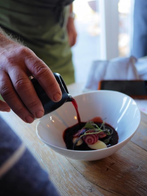 Simon Rogan pouring Beetroot Broth over the Westcombe Cheese Dumplings