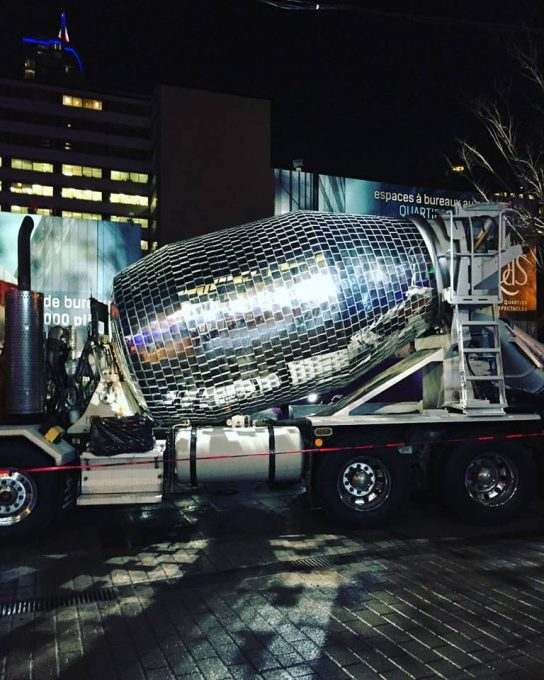 """Only in Montreal! As part of @mtlenlumiere Festival en Lumière here's one of the Illuminart pieces of art! A Disco Ball Cement Mixer! @illuminartmtl it's installation in the heart of the Festival is to encourage, and I quote, """"this freaky, daring diversion invites everyone to hit the improvised dance floor for a huge open air party"""""""