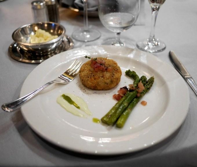MEDITERRANEAN-STYLE SPINY LOBSTER CAKE, TARRAGON FOAM Cured Olives, Grilled Asparagus