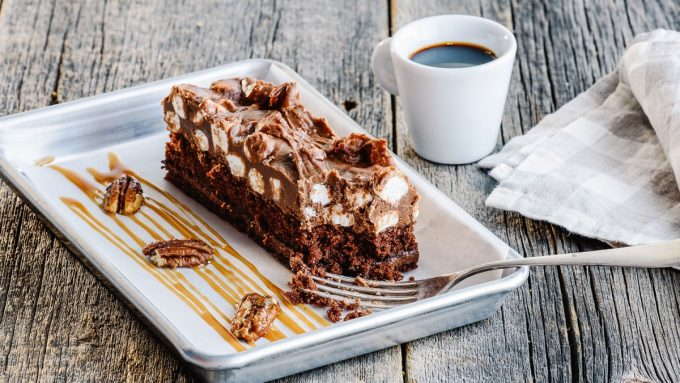 KING PLANK CHOCOLATE CAKE chocolate fudge frosting, caramel drizzle, crushed candied pecans