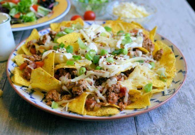 "Delicious, low-calorie and low-fat nachos made with healthy turkey ragu. These nachos would make a great ""fakeaway"" meal for all the family."